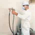 Spraying a new coating onto wall